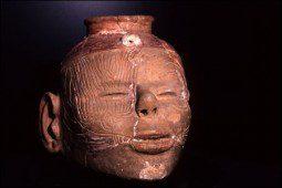 Caddoan head pot with bird design engraved around eye