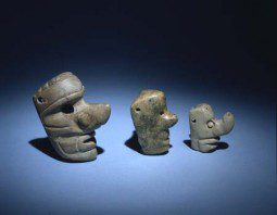 Long-nosed God pendants from Guatemala